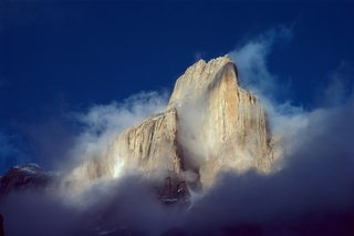 Trango Tower in morning mist, Karakoran Mountains, Pakistan